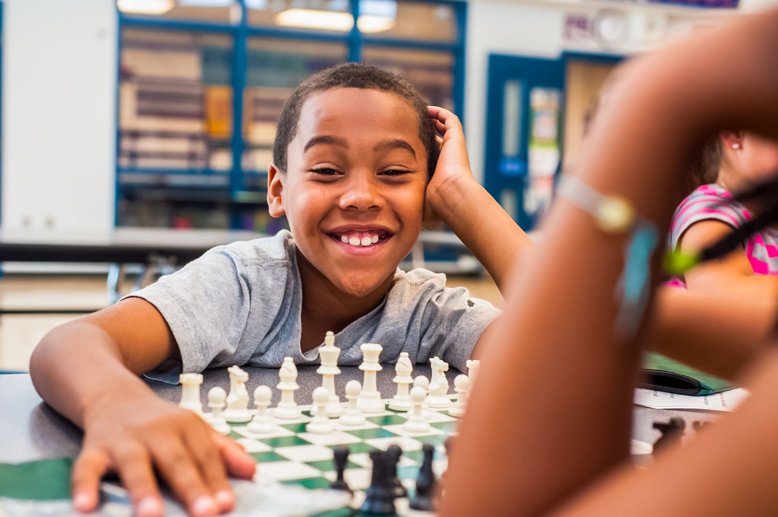 Boy Smiling Playing Chess